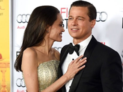 20 Photos Of Brad Pitt And Angelina Jolie Looking In Love Through The Years