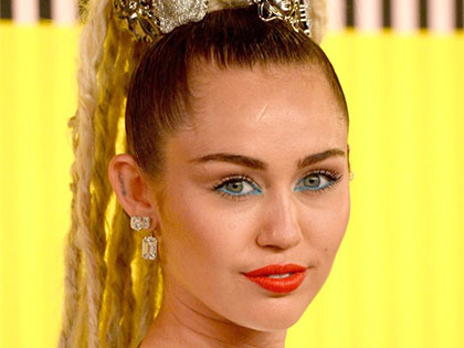 27 Photos Of Miley Cyrus' Unique Outfits